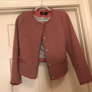 A grey and coral knit jacket